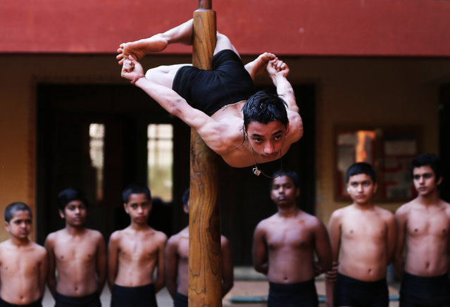 """A participant practices """"Mallakhamb"""" (traditional Indian gymnastics) during a practice session for the upcoming competition to promote the sport, in Ahmedabad, India, January 28, 2019. (Photo by Amit Dave/Reuters)"""