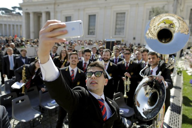 A musician takes a selfie with others members of his band during Pope Francis' Wednesday general audience in Saint Peter's Square at the Vatican April 8, 2015. (Photo by Tony Gentile/Reuters)