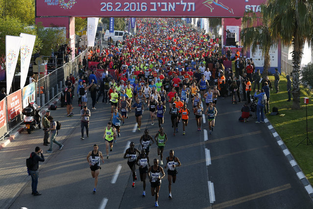 Runners take part in a marathon in Tel Aviv, Israel February 26, 2016. (Photo by Amir Cohen/Reuters)