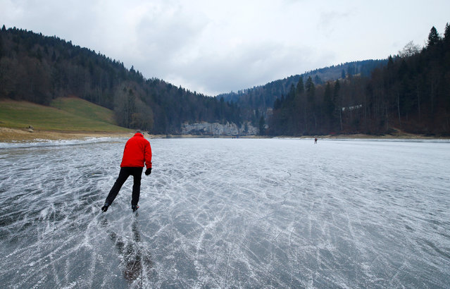 People skate on the frozen Doubs river at the Swiss - French border in Les Brenets, Switzerland, January 2, 2017. (Photo by Denis Balibouse/Reuters)