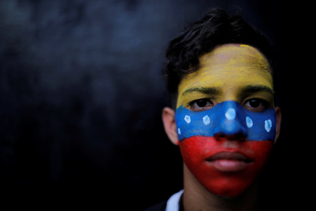 A protester poses for a portrait during a rally against Venezuelan President Nicolas Maduro's government in Caracas, Venezuela February 2, 2019. (Photo by Carlos Barria/Reuters)