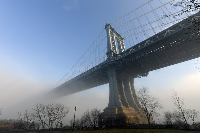 NYC morning fog. Wednsday, January 15, 2014, morning dense fog creates spectacular views over the East river of lower Manhattan, Brooklyn and Manhattan bridges as New Yorkers and tourist admire the scenery.  View from Brooklyn Bridge Park in DUMBO Brooklyn. (Photo by Paul Martinka/New York Post)
