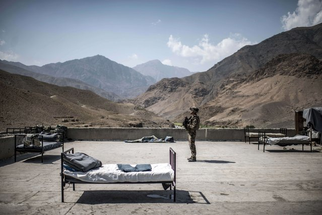 A French soldier stands on a rooftop of an Afghan National Police (ANP) combat post on September 24, 2012, in a village on the road to Naghlu the French army base. (Photo by Jeff Pachoud/AFP Photo)