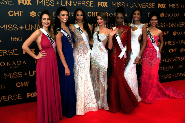Miss Universe candidates pose for a picture during a red carpet inside a SMX convention in metro Manila, Philippines January 29, 2017. In Photo from L-R: Miss Israel Yam Kaspers Anshel, Miss Namibia Lizelle Esterhuizen, Miss Haiti Raquel Pelissier, Miss Germany Johanna Acs, Miss Kenya Mary Esther Were, Miss Jamaica Isabel Dalley and Miss Mauritius Kushboo Ramnawaj. (Photo by Romeo Ranoco/Reuters)