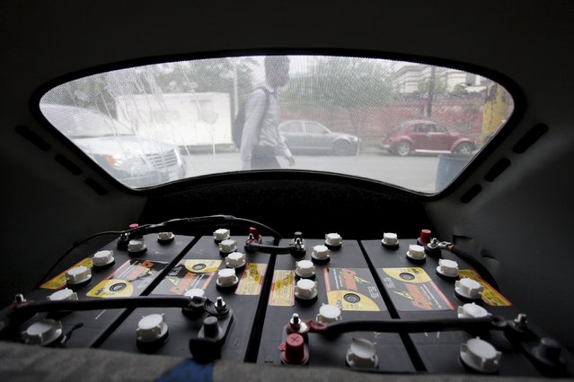 """Batteries are seen in the engine compartment of a VW Beetle 1995, locally called """"Vocho"""", in Monterrey April 22, 2015. (Photo by Daniel Becerril/Reuters)"""