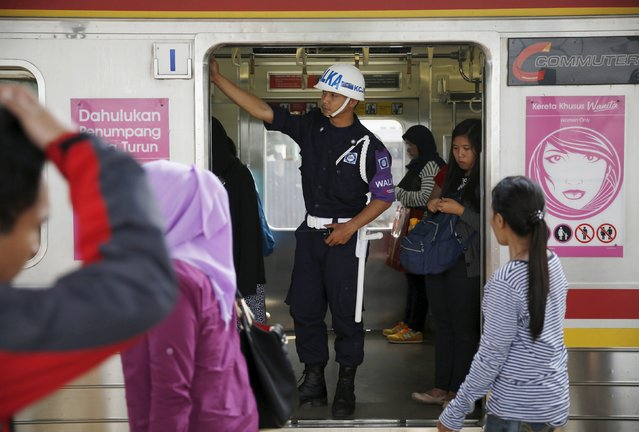 A security personnel stand guard inside train carriage for women at Manggarai train station in Jakarta, January 8, 2016. (Photo by Reuters/Beawiharta)