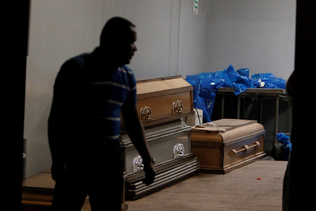 A man stands by coffins at the morgue in Tegucigalpa, Honduras, February 5, 2017, after a crash between a bus and a truck on the outskirts of the capital. (Photo by Jorge Cabrera/Reuters)