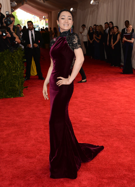 """Chinese actress Gong Li arrives at The Metropolitan Museum of Art's Costume Institute benefit gala celebrating """"China: Through the Looking Glass"""" on Monday, May 4, 2015, in New York. (Photo by Evan Agostini/Invision/AP Photo)"""