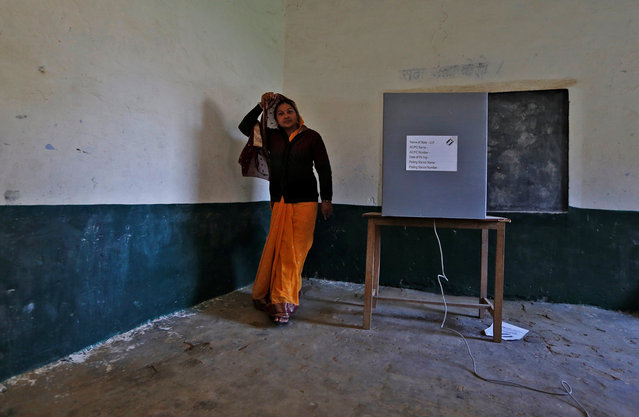 A woman leaves after casting her vote at a polling booth during the state assembly election in Hapur, in the central state of Uttar Pradesh, India, February 11, 2017. (Photo by Adnan Abidi/Reuters)
