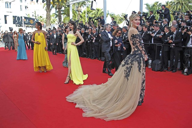 """Actress and model Hofit Golan (R) poses on the red carpet as she arrives for the opening ceremony and the screening of the film """"La tete haute"""" out of competition during the 68th Cannes Film Festival in Cannes May 13, 2015. (Photo by Eric Gaillard/Reuters)"""