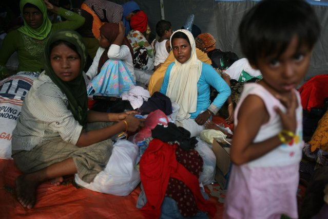 Ethnic Rohingya women sit inside a tent in Langsa, Aceh province, Indonesia, Saturday, May 16, 2015. (Photo by Binsar Bakkara/AP Photo)