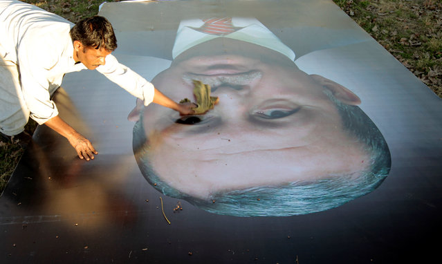 A worker cleans the picture of Turkish President Recep Tayyip Erdogan as workers put up images of the heads of state scheduled to visit Islamabad to attend the 13th Economic Cooperation Organization Summit (ECO) in Islamabad, Pakistan February 26, 2017. (Photo by Caren Firouz/Reuters)