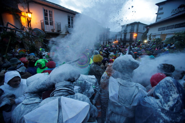 """Revellers participate in a flour fight during the """"O Entroido"""" festival in Laza village, Spain February 27, 2017. (Photo by Miguel Vidal/Reuters)"""