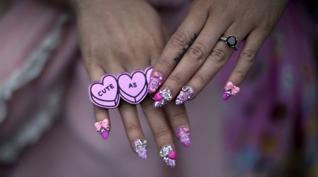 Guest Bebe Le shows her fingernails during Disneyland's Diamond Celebration in Anaheim, California May 22, 2015. (Photo by Mario Anzuoni/Reuters)