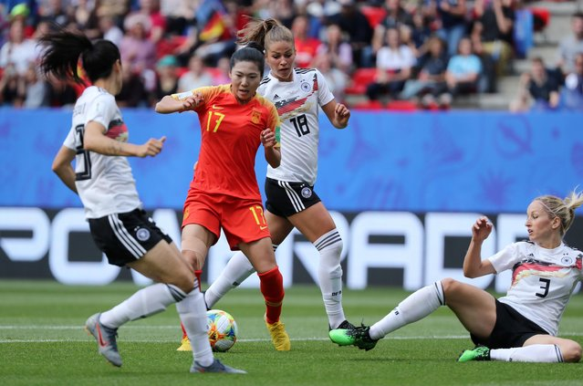 China's Yasha Gu in action with Germany's Kathrin Hendrich and Melanie Leupolz during the FIFA women's World Cup 2019 group B match between Germany and China at the Roazhon Park in Rennes, France on June 8, 2019. (Photo by Lucy Nicholson/Reuters)