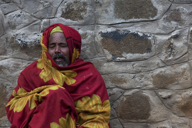 A man prays near the Entoto Maryam church on the outskirts of Addis Ababa, Ethiopia, May 16, 2015. (Photo by Siegfried Modola/Reuters)