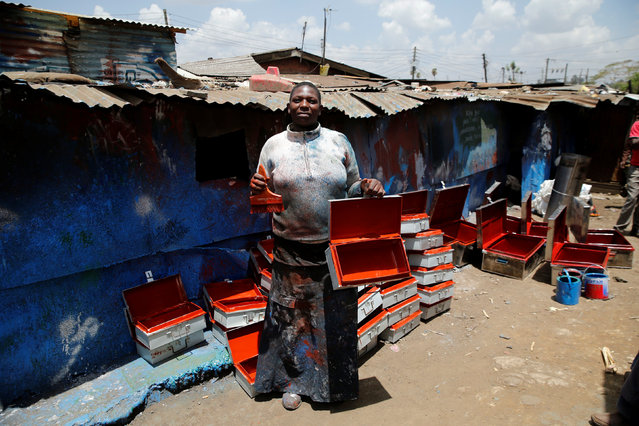 """Christine Akoth, 38, a metal painter, poses for a photograph in Kenya's capital Nairobi, February 27, 2017. """"I have experienced gender bias at my work where sometimes I'm denied contracts because of who I am and maybe my marital status. Some female colleagues have been treated unfairly because of their s*x and even exploited"""", Akoth said. (Photo by Thomas Mukoya/Reuters)"""