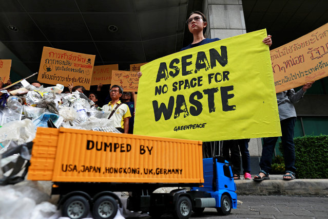 Greenpeace activists protest in front of the Foreign Ministry ahead of the 34th ASEAN summit in Bangkok, Thailand on June 20, 2019. (Photo by Soe Zeya Tun/Reuters)
