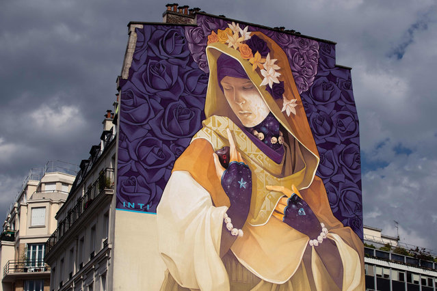 """A picture taken on June 13, 2019 shows a mural titled """"La Madre Secular 2"""" by street-artist INTI, as part of the open air street-art display """"Boulevard Paris 13"""" in Paris. (Photo by Joel Saget/AFP Photo)"""