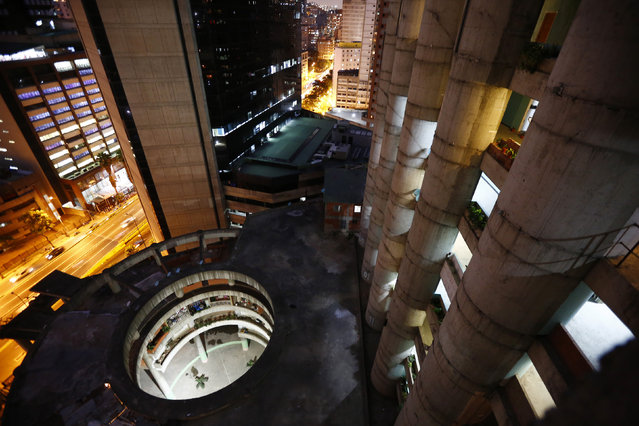 """A view of the lobby from the top of the """"Tower of David"""" skyscraper in Caracas February 3, 2014. (Photo by Jorge Silva/Reuters)"""