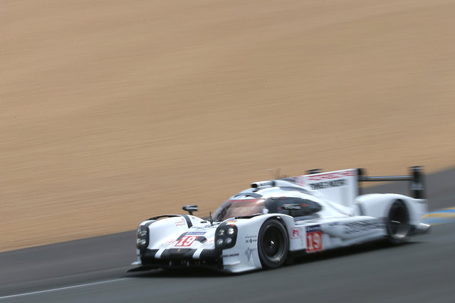 The Porsche 919 Hybrid No19 of the Porsche Team driven by Nico Hulkenberg of Germany, Earl Bamber of New Zealand and Nick Tandy of Great Britain is seen in action during the 83rd 24-hour Le Mans endurance race, in Le Mans, western France, Saturday, June 13, 2015. (AP Photo/David Vincent)