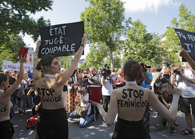"""Femen activists hold placards during a rally against women violence in Paris, Saturday, July 6, 2019. France has registered more than 70 such alleged killings so far his year, according to a Facebook group tracking them. The current government has promised to accelerate measures to protect abused women. Placards read, left, """"state is guilty"""", right, """"stop to femicide"""". (Photo by Michel Euler/AP Photo)"""