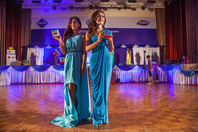 Professional models from Sun Model Agency present a new product being marketed in Cambodia during a show at the Sofitel Hotel on March 30, 2014 in Phnom Penh, Cambodia. (Photo by Omar Havana/Getty Images)