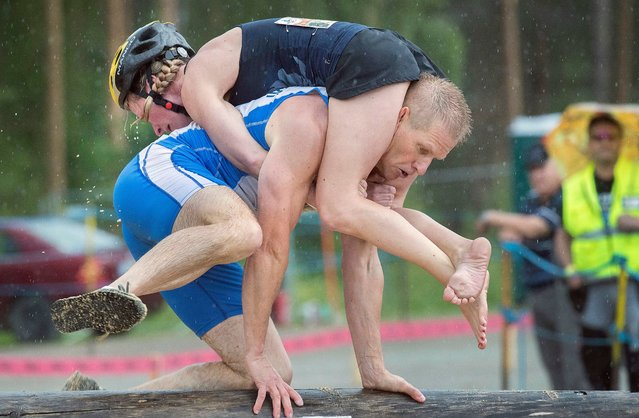Competitors Taisto Miettinen and Katja Kovanen fron Finland participate in the annual Wife Carrying World Championships in Sonkajarvi, Finland on July 6, 2019. People from all over the world took part in the event that was founded in 1992. (Photo by Mauri Ratilaine/EPA/EFE/Rex Features/Shutterstock)