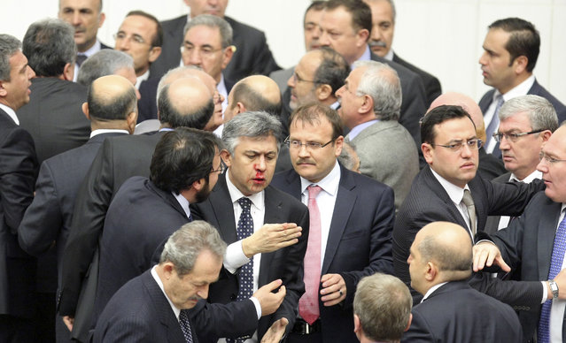 Member of parliament (MP) from the main opposition Republican People's Party (CHP) Ali Ihsan Kokturk's nose bleeds as MPs from the ruling AK Party (AKP) and CHP scuffle during a debate on a draft law which will give the government tighter control over the appointment of judges and prosecutors, at a parliamentary session in Ankara early February 15, 2014. (Photo by Reuters/Stringer)
