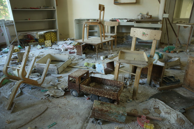 "Toys and children's chairs lie in the ""Zlataya ribka"" (""Golden little fish"") abandoned kindergarten on September 30, 2015 in Pripyat, Ukraine. (Photo by Sean Gallup/Getty Images)"