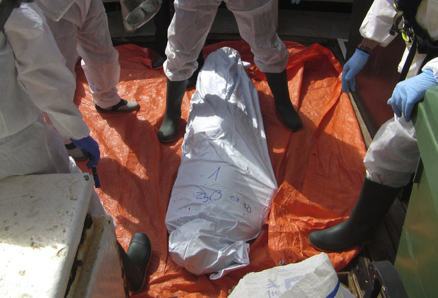 In this photo released by Proactiva Open Arms NGO on Friday, March 24, 2017, the body of a migrant on board the Golfo Azzurro, the Spanish NGO Proactiva Open Arms rescue ship on the Mediterranean Sea off the Libyan coast, during a search and rescue operation by Spanish NGO Proactiva Open Arms. (Photo by Proactiva Open Arms via AP Photo)