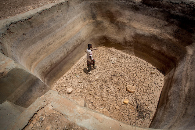 A man walks in a dry underground water pan in the drought-stricken Baligubadle village near Hargeisa, the capital city of Somaliland, in this handout picture provided by The International Federation of Red Cross and Red Crescent Societies on March 15, 2017. (Photo by Reuters/The International Federation of Red Cross and Red Crescent Societies)