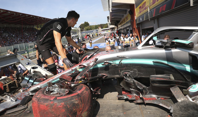 Pit crew inspect the damaged car of Mercedes driver Lewis Hamilton of Britain after Hamilton hit a barrier during the third practice session ahead of the Belgian Formula One at Spa-Francorchamps, Belgium, Saturday, August 31, 2019. The Belgian Formula One race will take place on Sunday. (Photo by Francisco Seco/AP Photo)