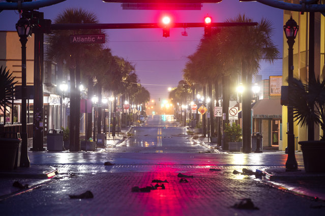 With a mandatory evacuation order in effect, the streets are deserted in downtown Daytona Beach as Hurricane Dorian passes 90 miles offshore in Daytona Beach, Florida, USA, 04 September 2019. Hurricane Dorian, a Category 2 storm that was expected to hammer Florida largely spared the state. (Photo by Jim Lo Scalzo/EPA/EFE)