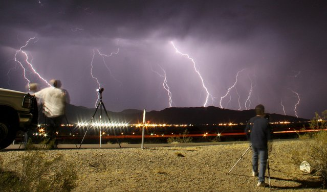 Southern California storm chasing photographers take pictures of the mass lightning bolts lighting up night skies from monsoon storms passing over the high deserts early Wednesday, north of Barstow, California, July 1, 2015. Picture taken using long exposure. (Photo by Gene Blevins/Reuters)