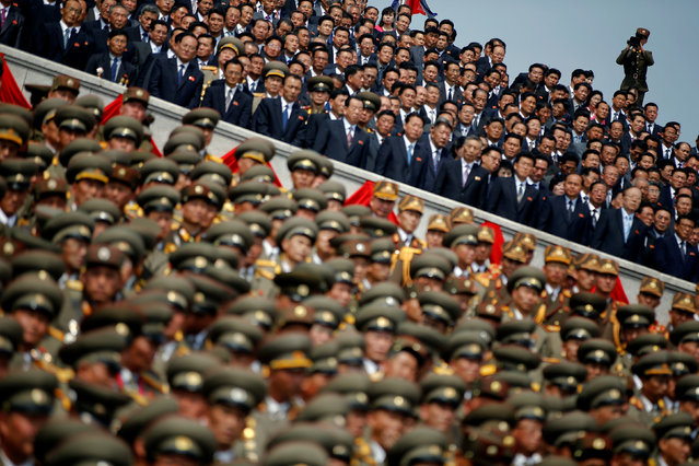 A soldier films North Korean soldiers, officers and high ranking officials  attending a military parade marking the 105th birth anniversary of country's founding father Kim Il Sung in Pyongyang, North Korea, April 15, 2017. (Photo by Damir Sagolj/Reuters)