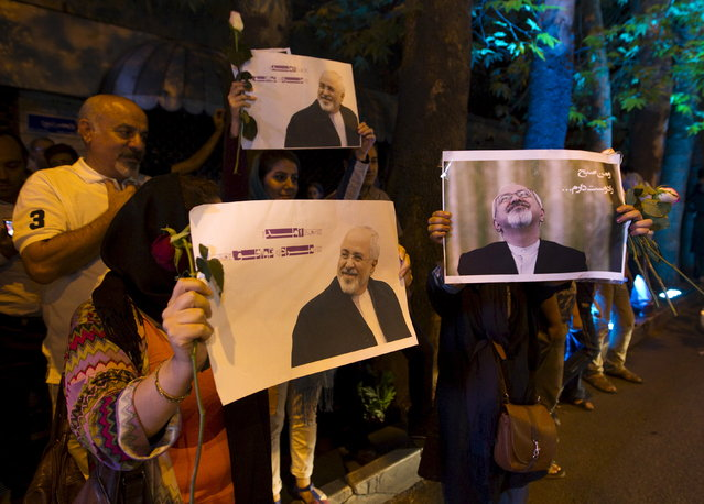 Iranians hold pictures of Iranian Foreign Minister Mohammad Javad Zarif as they celebrate in the street following a nuclear deal with major powers, in Tehran July 14, 2015. (Photo by Reuters/TIMA)