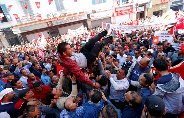 A member of the Tunisian General Labour Union (UGTT) is thrown into the air by his colleagues during a rally to mark International Workers' Day, or Labour Day, in Tunis, Tunisia on May 1, 2017. (Photo by Zoubeir Souissi/Reuters)