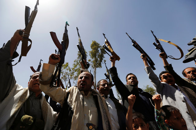 Tribesmen loyal to the Houthi raise up their rifles during a gathering to show support to the movement in Sanaa, Yemen, May 19, 2016. (Photo by Khaled Abdullah/Reuters)