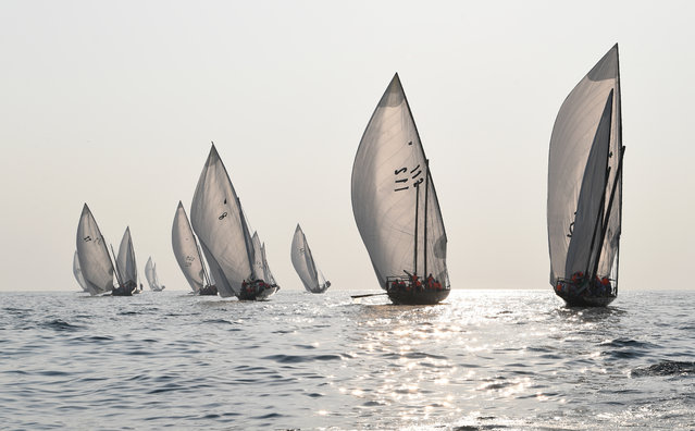 Emirati competitors sail their dhows as they take part in the Dalma Sailing Festival in the waters of Dalma island in the Gulf, about 40 kms off of the Emirati capital Abu Dhabi, on October 22, 2019. (Photo by Karim Sahib/AFP Photo)