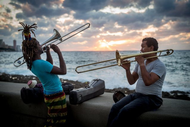 Street musicians play for change at sunset on the Malecon in Old Havana on the evening of May 5, 2016. (Photo by Dotan Saguy)