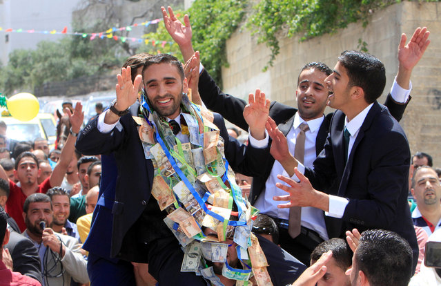 Palestinian groom Mosa Aamer is carried by relatives as they celebrate his wedding in the West Bank village of Kof Qaleel near Nablus May 6, 2016. (Photo by Abed Omar Qusini/Reuters)