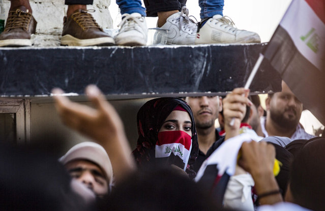 Iraqi students take part in an anti-government demonstration in front of their university in the centre of the southern city of Basra on October 29, 2019. Swathes of Iraq have been engulfed by two waves of demonstrations this month over unemployment and corruption that have evolved into demands for regime change. (Photo by AFP Photo/Stringer)