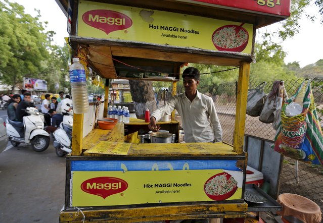 A vendor works at a roadside Maggi noodles eatery in Ahmedabad, India, in this June 4, 2015 file photo. Nestle, producer of Maggi instant noodles, is expected to report H1 results this week. (Photo by Amit Dave/Reuters)
