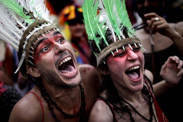 Revelers sing during a 'Ceu na Terra' street parade in Rio de Janeiro