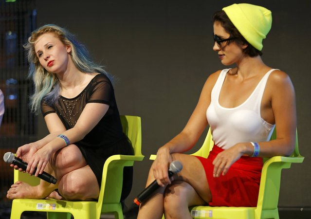 """""""p*ssy Riot"""" members Nadezhda Tolokonnikova (R) and Maria Alyokhina attend a roundtable discussion at Sziget Festival in Budapest, Hungary August 14, 2015. (Photo by Laszlo Balogh/Reuters)"""
