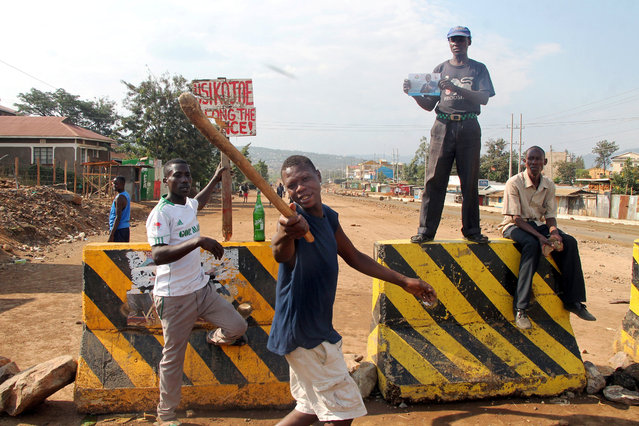 Demonstrators supporting opposition leader Raila Odinga confront Kenyan riot police in Kisumu, Kenya August 9, 2017. (Photo by James Keyi/Reuters)