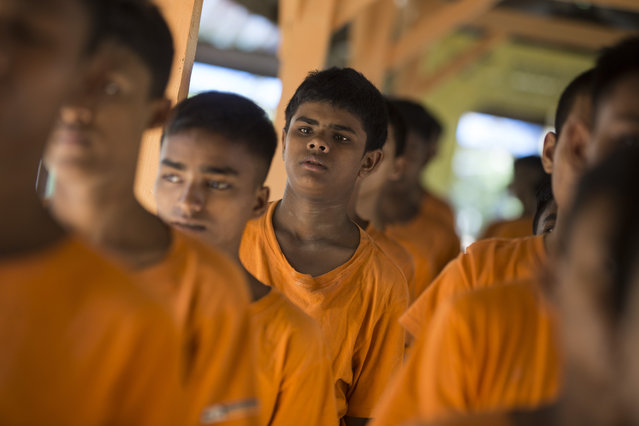 Some Rohingya boys queue for lunch at Hnget Awe San Youth Rehabilitation Center in Kawhmu township of Yangon, Myanmar, on October 20, 2019. 35 out of all 564 trainees at the center are Rohingya Muslims from Rakhine state who were convicted of attempt to travel to Myanmars largest city Yangon and then to Malaysia without having any valid documents. (Photo by AungNaingSoe/Anadolu Agency via Getty Images)