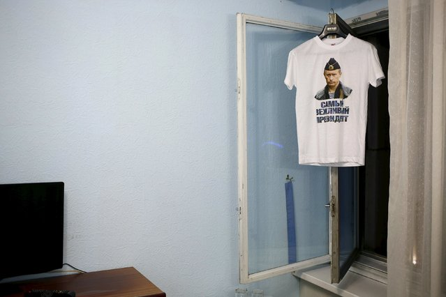 """A t-shirt with a picture of Russian President Vladimir Putin and which reads """"The most polite President"""" is seen in this photo illustration taken in a hotel room in Kazan, Russia, August 2, 2015. (Photo by Stefan Wermuth/Reuters)"""