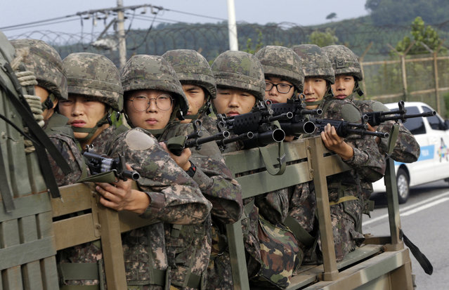 South Korean army soldiers ride on a truck in Paju, south of the demilitarized zone that divides the two Koreas, South Korea, Monday, August 24, 2015. (Photo by Ahn Young-joon/AP Photo)